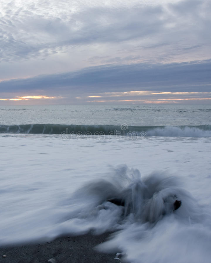Download Driftwood, Waves And Sunset Stock Image - Image: 10371563