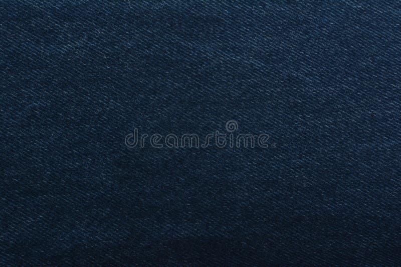 Dril de algodón de la textura Tejido denso textiles Fondo Tela natural azul marino imagen de archivo libre de regalías