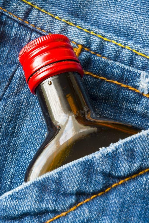 Dril de algodón y whisky fotografía de archivo libre de regalías
