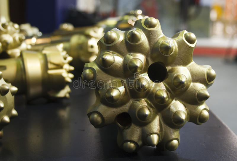 Drill bit. Golden oil rig drill bit detail stock photography