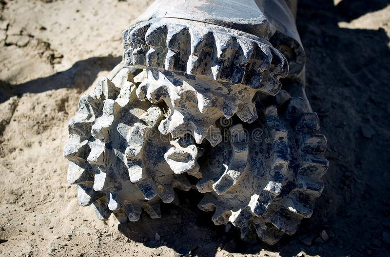 Drill bit. For drilling in soft rocks, sand, clay royalty free stock photography