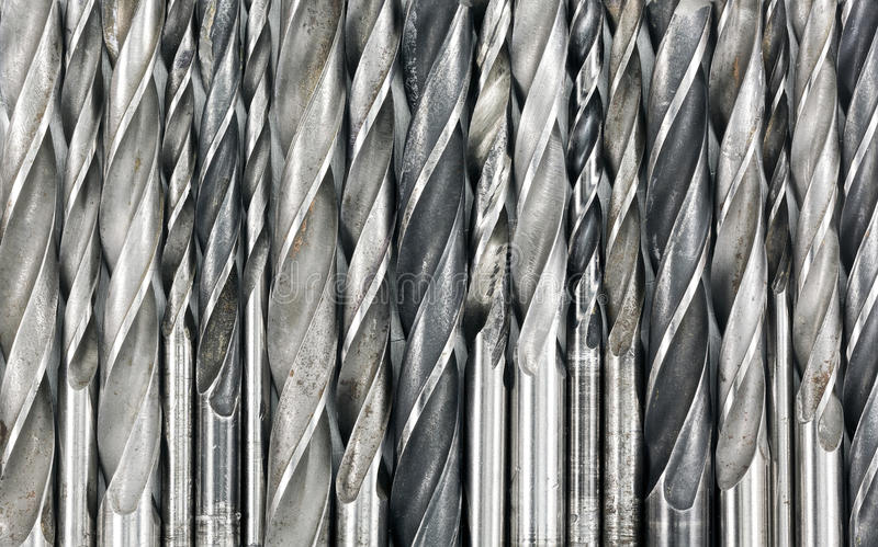 Drill bits background. Various used metal drill bits pattern background stock images