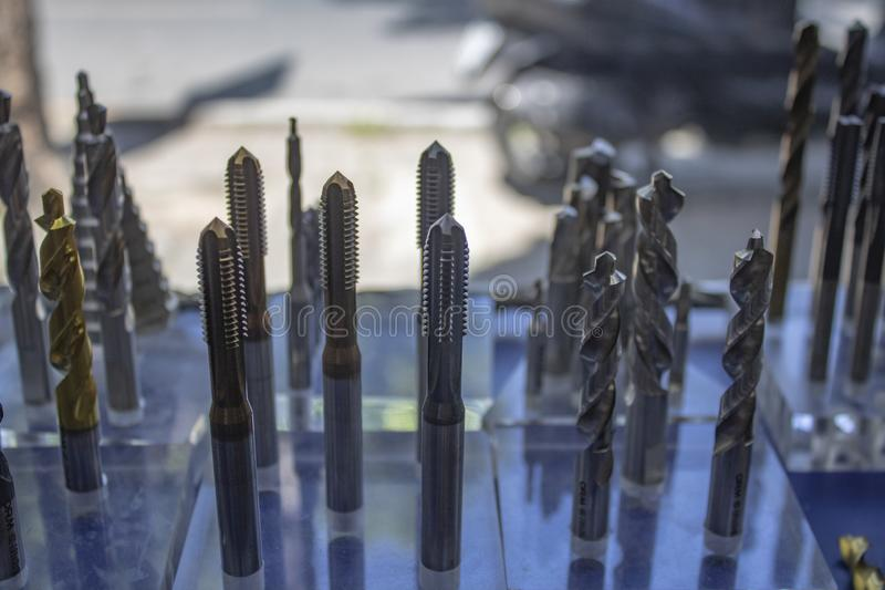 Drill bits on the shelf royalty free stock photo
