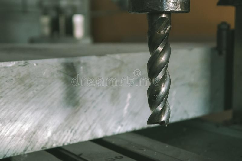Drill on metal materials on the machine. stock photography