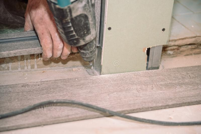 Drill Puncher. Punch hole. Tool for slotting. Punch on the floor. Broken concrete stock image