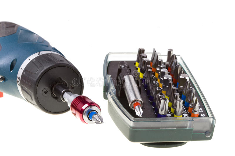 Drill-screwdriver electric storage and set of nozz stock photos