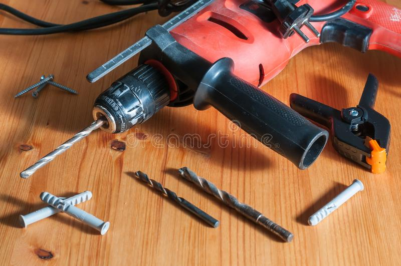 A drill on a wood table stock photos