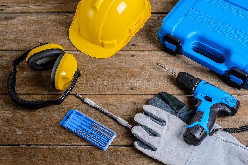 Drill and set of drill,tools,carpenter and safety, Protection Equipment stock photo