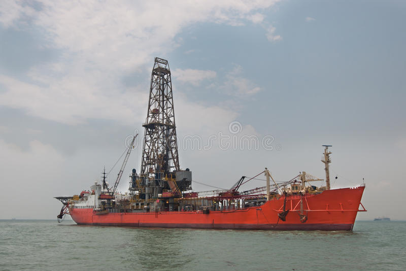 Drill Ship. Lying afloat at the OPL (Out-Port-Limit) offshore Singapore awaiting for commencement of mobilization to a well location royalty free stock photos