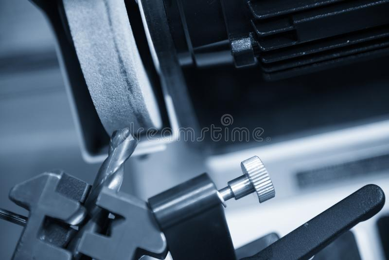 The drill tool regrinding with the grinding machine. royalty free stock image