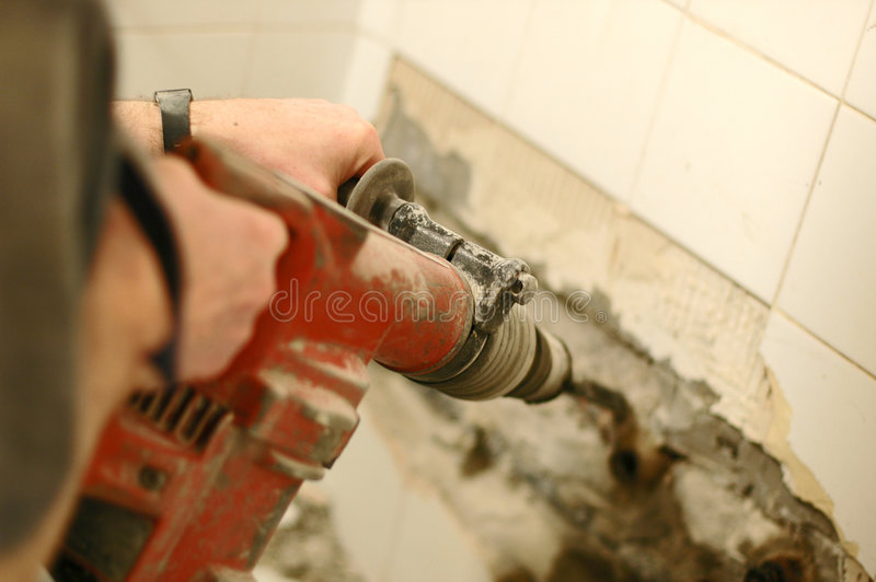 Drilling and demolition stock photos