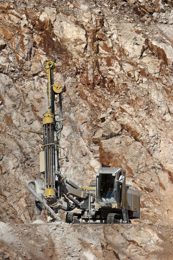Download Drilling Holes For Demolition In A Quarry Stock Photo - Image: 31914970