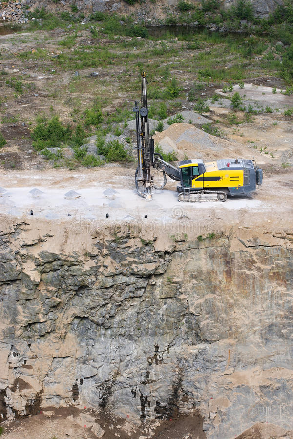 Drilling machine. In open cast mining quarry stock photos