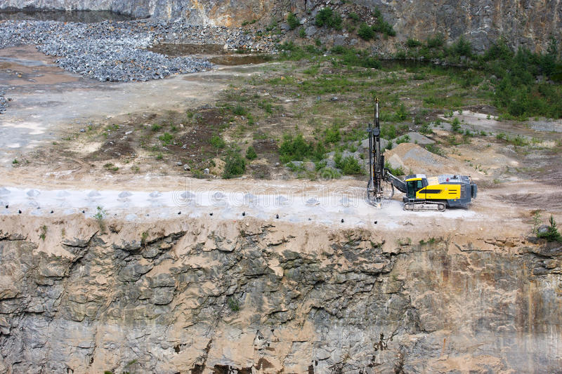 Drilling machine. In open cast mining quarry royalty free stock photography
