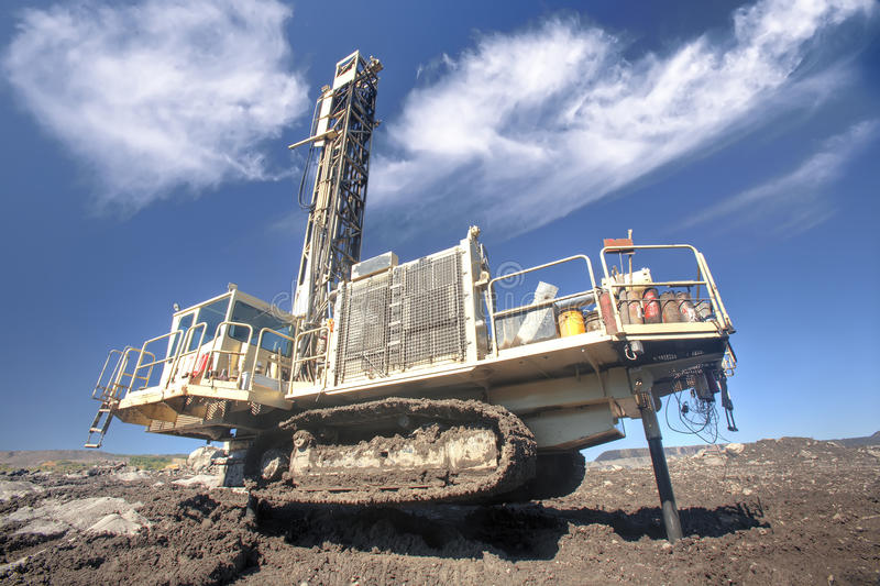 DRILLING MACHINE. Heavy drilling machine at worksite stock photos