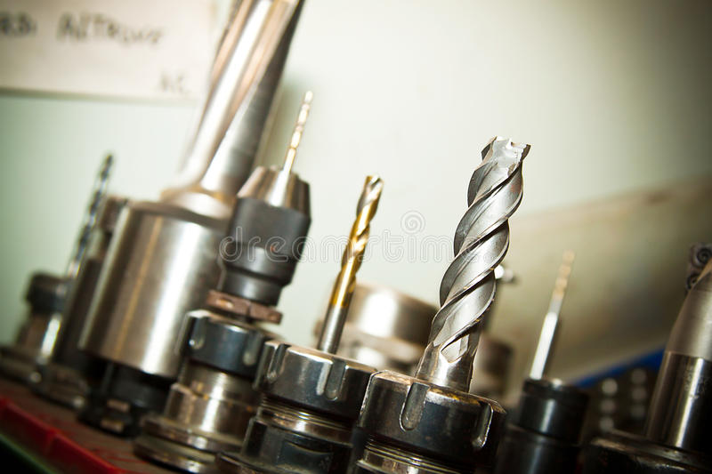 Drilling machine. Detail of drilling machine bits in a high precision mechanics plant stock images