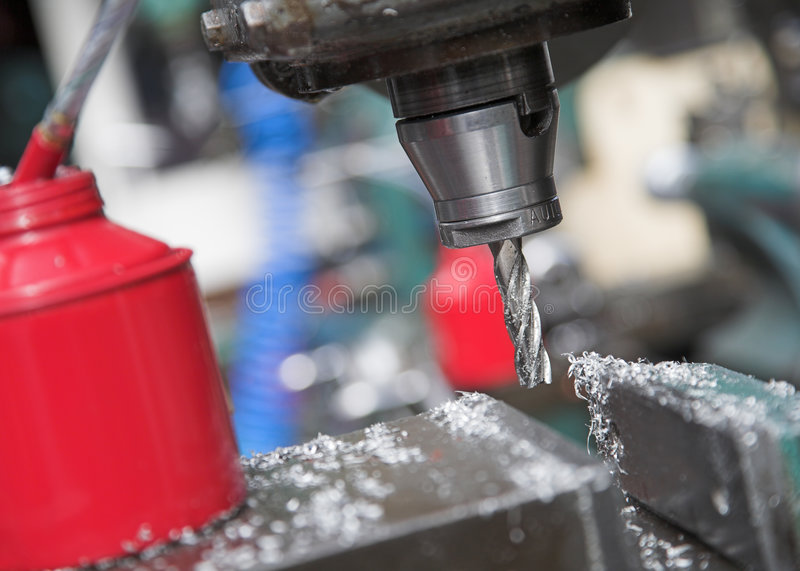 Drilling Machine. An industrial drilling machine and oil can in an engineering workshop royalty free stock photos