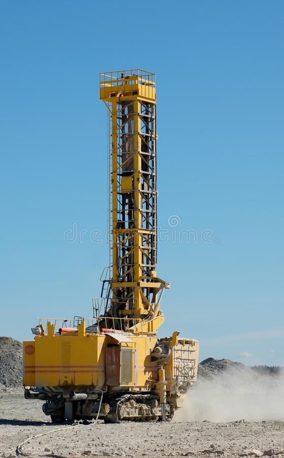 Drilling machine. Heavy drilling machine in open pit royalty free stock image