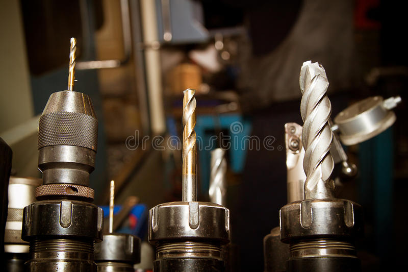 Drilling machine bits. In a high precision mechanics plant stock image