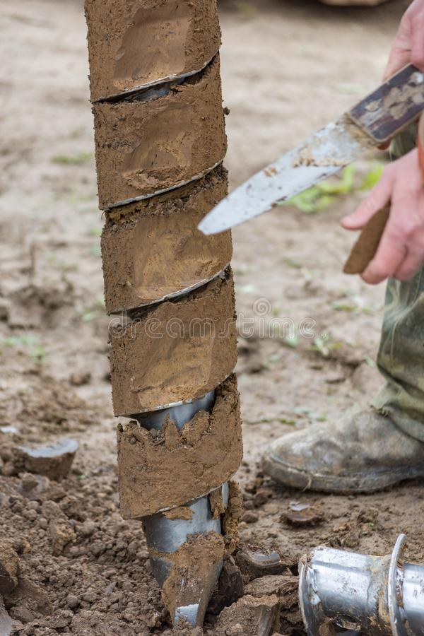 Drilling machine for drilling holes. In the ground royalty free stock photography