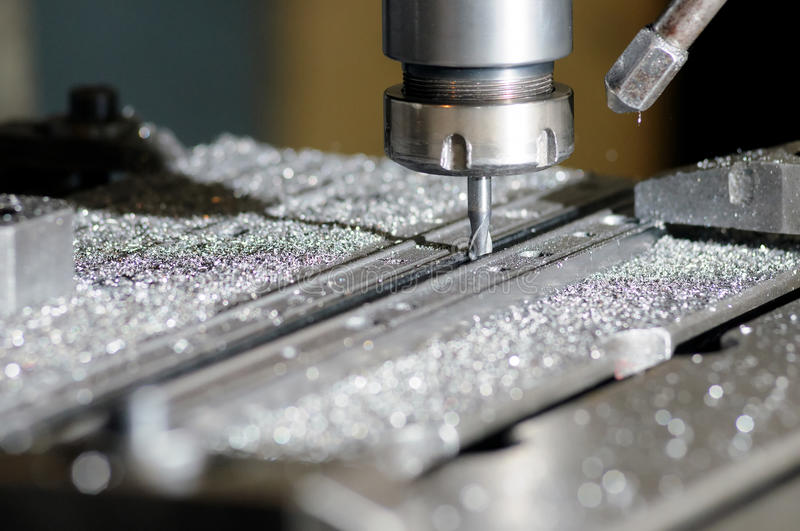 Drilling machine. In a factory in action stock photos