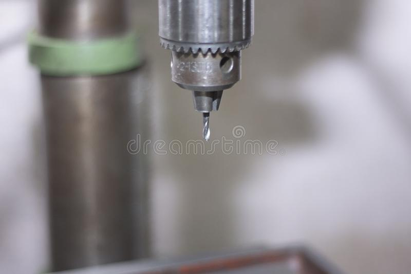 Drilling machine in a factory in action royalty free stock photography