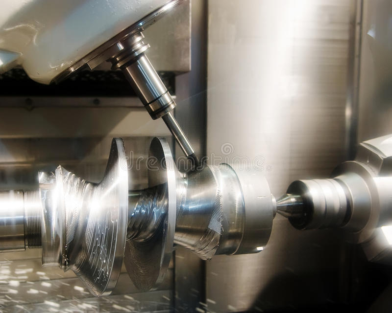 Drilling machine workpiece. A metal workpiece being processed on a drilling machine stock photo