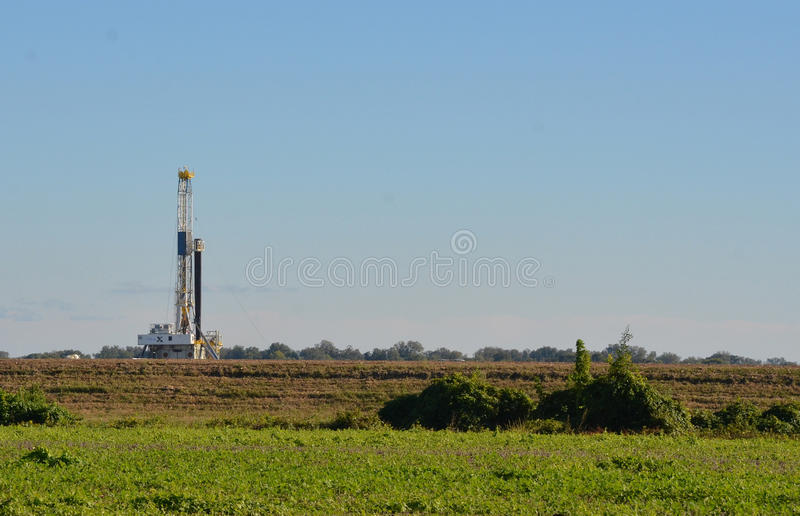 Drilling Rig in cotton field stock photography