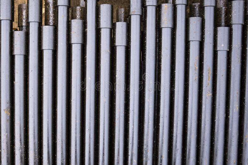 Drilling of oil and gas wells. Drill pipe inspection. Tubing for oil and gas listed on the pedestal out of the wells after washing. And ready for inspection royalty free stock photo