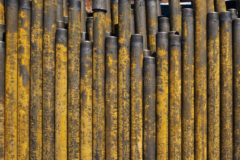 Drilling of oil and gas wells. Drill pipe inspection. Tubing for oil and gas listed on the pedestal out of the wells after washing royalty free stock photos