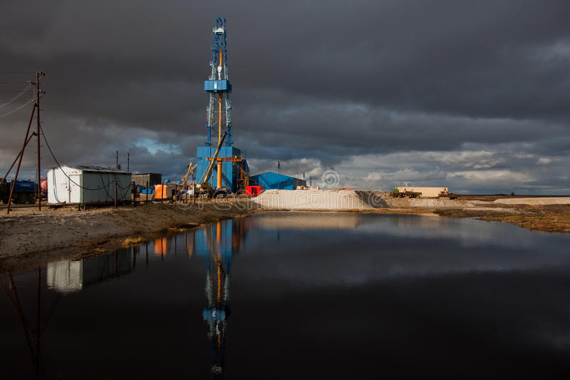 Drilling rig. In late autumn on the vast siberian gas field stock photography