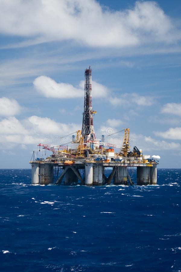 Drilling rig. Offshore sattionary dynamic posittioned drilling rig, with blue sky and clouds stock photography