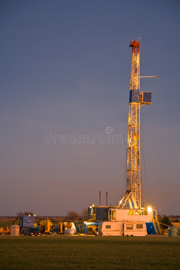 Drilling Rig-6919. Oil drilling rig in Oklahoma at twilight stock photo
