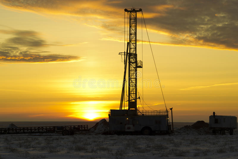 Drilling rig. The drilling rig against a sun dawn stock photo