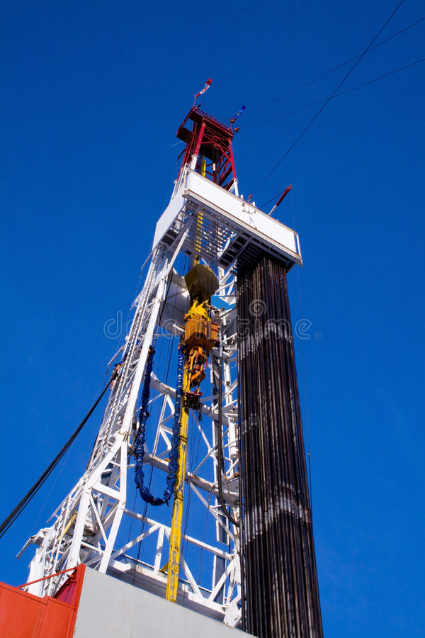 Drilling rig derrick with pipe. An upward view of a large drilling rig with pipe racked on the floor royalty free stock photos