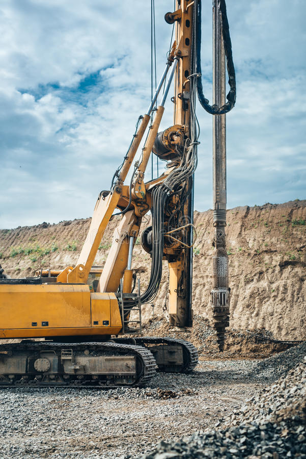 drilling rig machinery on highway construction site. Viaduct construction and bridge pillar details stock photography