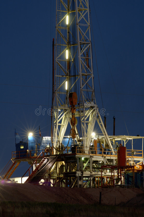 Drilling Rig at Night. Oil drilling rig in the Texas Panhandle royalty free stock photos