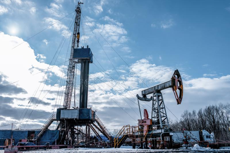 Drilling rig in oil field for drilled into subsurface in order to produced crude. royalty free stock photo