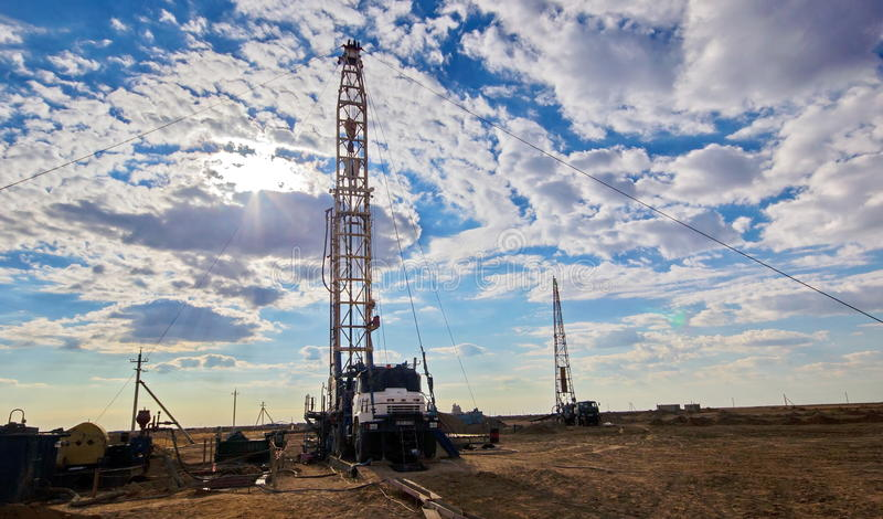 Drilling rig. Drilling rigs running in the steppe royalty free stock photo