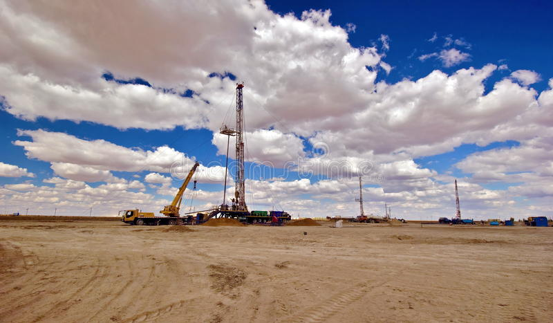 Drilling rig. Drilling rigs running in the steppe stock photo