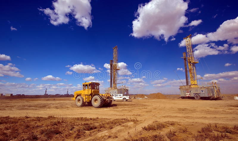 Drilling rig. Drilling rigs running in the steppe stock photos