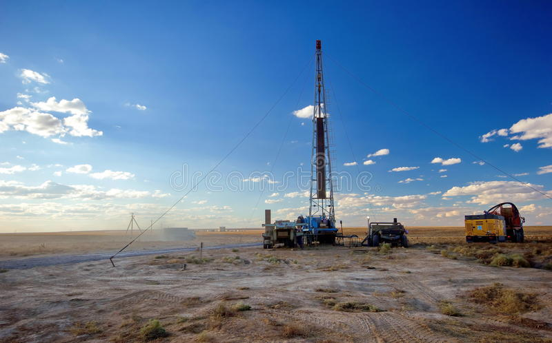 Drilling rig. Drilling rigs running in the steppe royalty free stock image