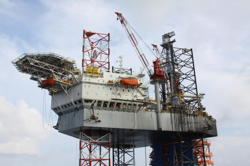 Drilling rig at the sea. Drilling rig at the sea in the morning stock photo