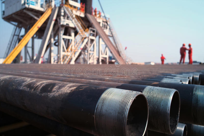 Drilling rig and worker. The drilling rig and worker stock photos