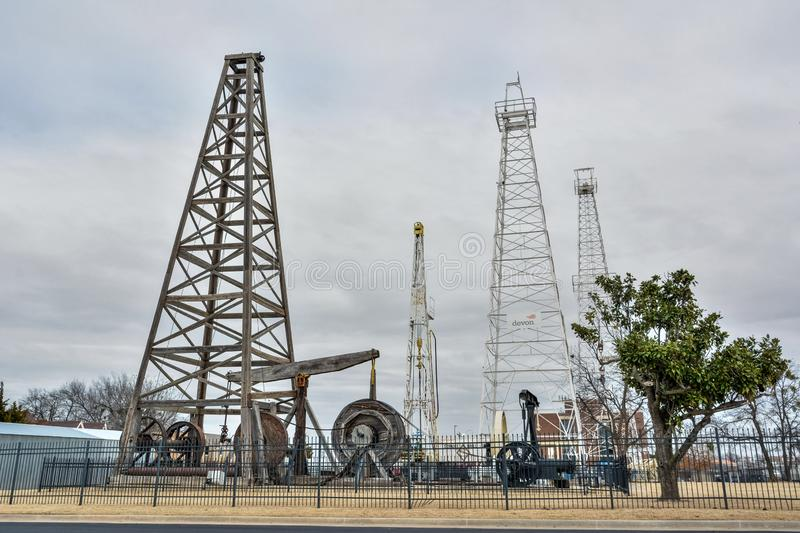 Drilling rigs and derricks located in Devon Oil and Gas Exploration Park in Oklahoma City, OK. Oklahoma City, Oklahoma, United States of America - January 18 stock images