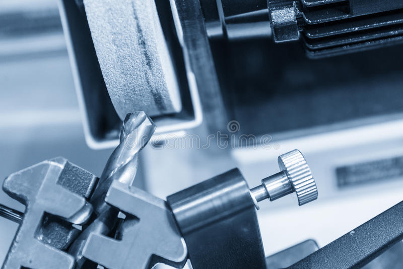 The drilling tool sharpener machine. In light blue scene.Tooling production concept royalty free stock image