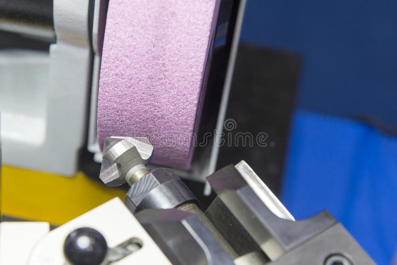 The drilling tool sharpener machine. In light blue scene.Tooling production concept stock image