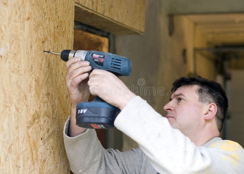 Download Drilling wooden wall stock photo. Image of contractor - 3830096