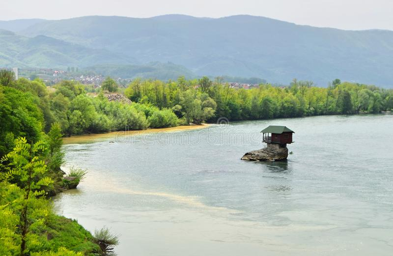 Drina River House Serbia. Drina River House. This tiny house stands on an exposed rock in the middle of the Drina River, near the town of Bajina Basta, Serbia stock photography