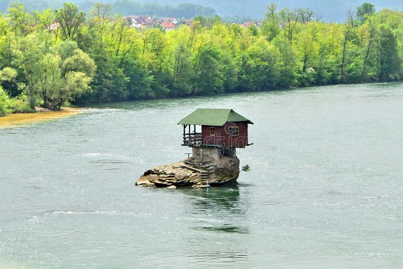 Drina River House Serbia. Drina River House. This tiny house stands on an exposed rock in the middle of the Drina River, near the town of Bajina Basta, Serbia stock image